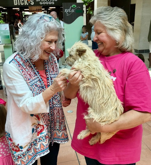 Lost Paws Rescue of Texas - Founder Yvette Garza, right, with Happy Adopter